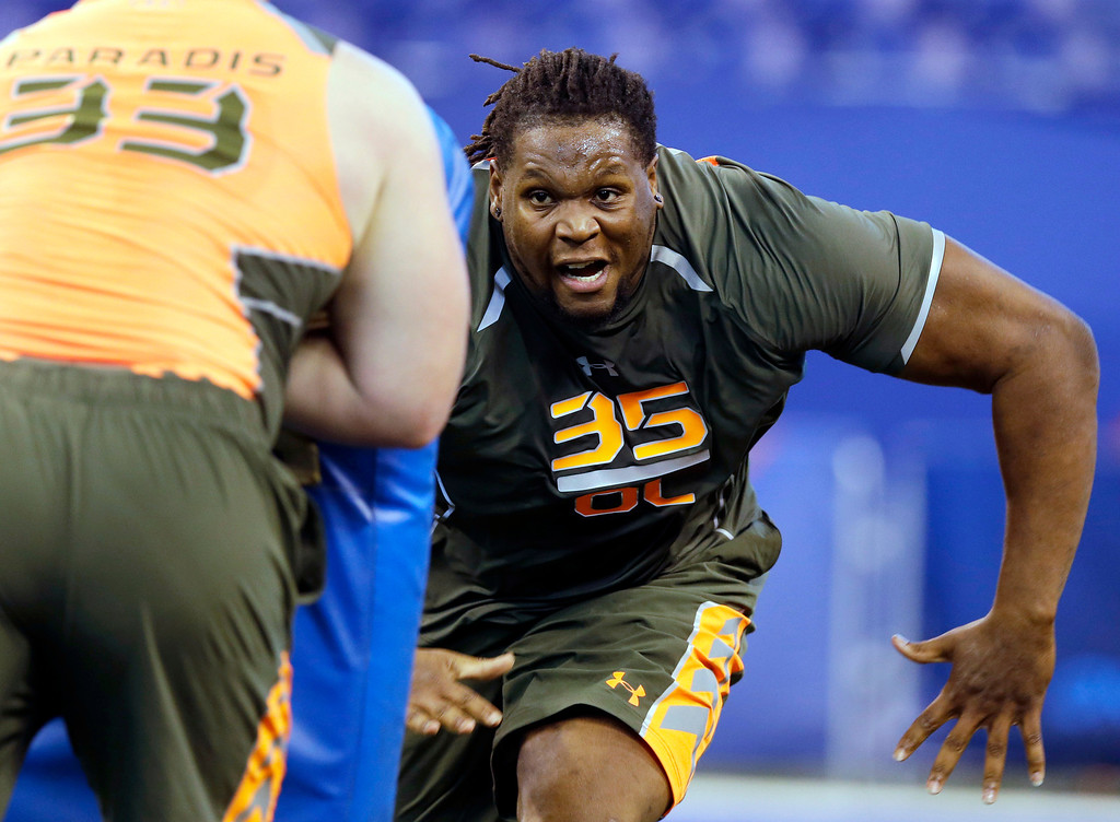. Tennessee offensive lineman Antonio Richardson (35) runs a drill at the NFL football scouting combine in Indianapolis, Saturday, Feb. 22, 2014. (AP Photo/Michael Conroy)