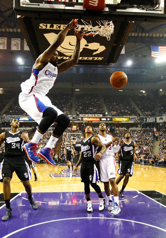 . Los Angeles Clippers center DeAndre Jordan hangs on the rim after dunking during the first quarter of an NBA basketball game against the Sacramento Kings in Sacramento, Calif., Wednesday, April 17, 2013. (AP Photo/Rich Pedroncelli)