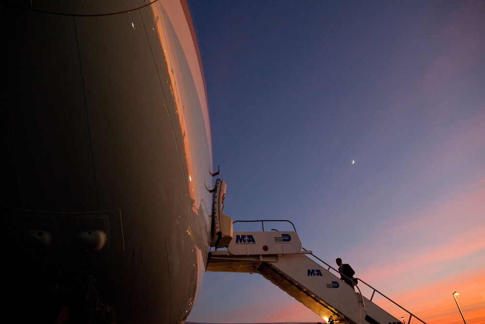 ". Oct. 11, 2010 ""The sun was setting as the Presidential motorcade arrived back at Miami International Airport. I ran to get in front of Air Force One so I could use the beautiful sky as the background when the President boarded the plane.\"" (Official White House Photo by Pete Souza)"