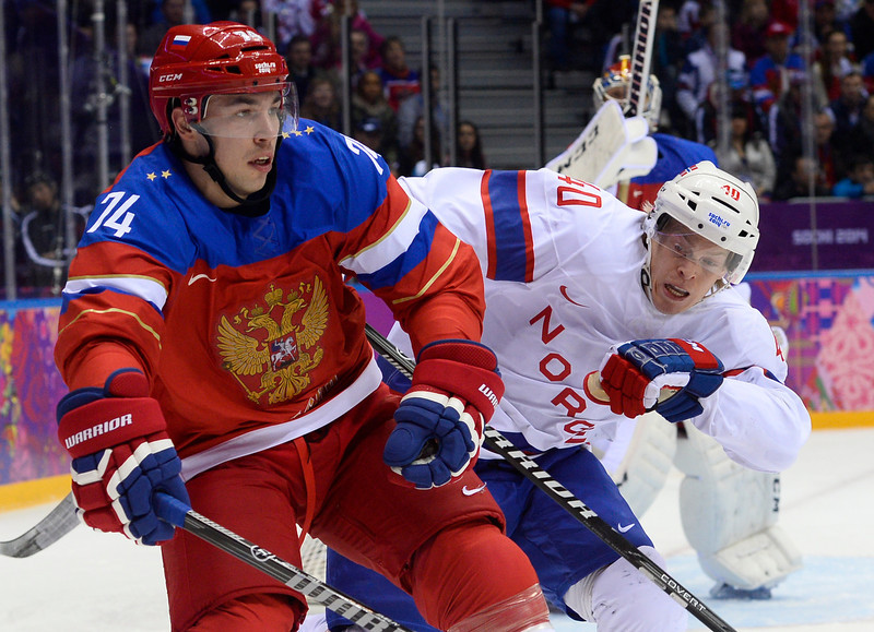 . Russia\'s Alexei Yemelin (L) vies with Norway\'s Ken Andre Olimb during the Men\'s Ice Hockey play-offs qualification match Russia vs Norway at the Bolshoy Ice Dome during the Sochi Winter Olympics on February 18, 2014.  (JONATHAN NACKSTRAND/AFP/Getty Images)