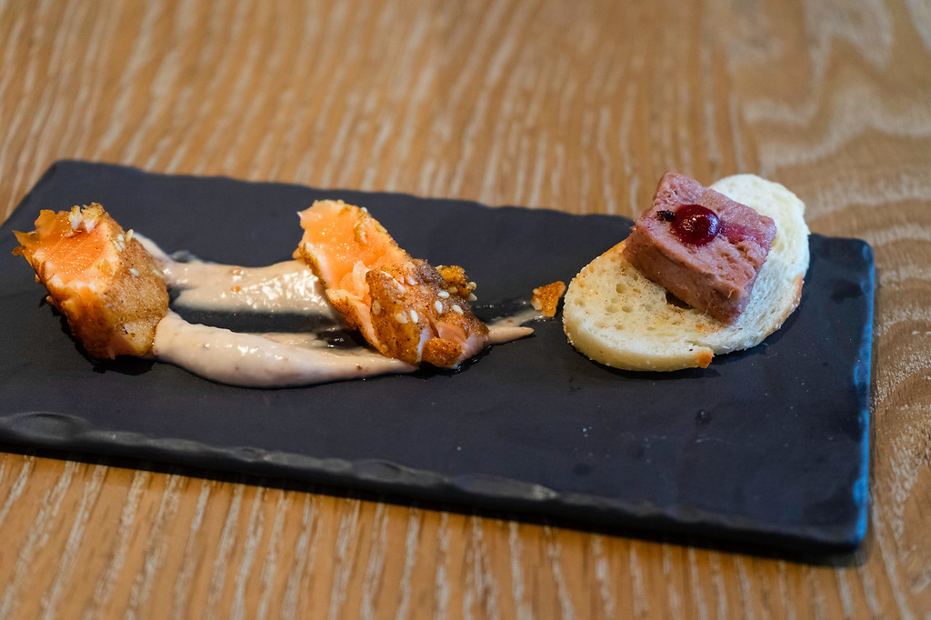 crostini with wild boar rillette topped with a dot of cranberry ketchup, and salmon tataki.