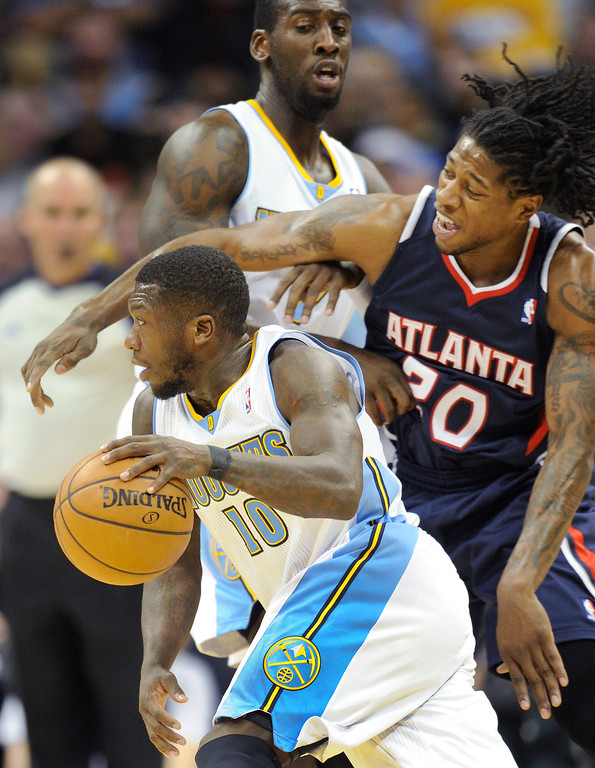 . Denver guard Nate Robinson (10) made his way to the basket in the second half.    Photo By Karl Gehring/The Denver Post