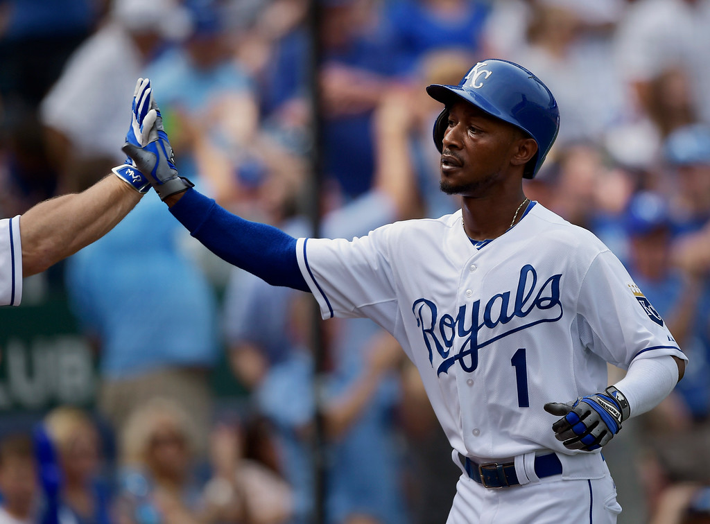 . Kansas City Royals center fielder Jarrod Dyson (1) high-fives a teammate after scoring the tying run (1-1) during the fifth inning of a baseball game Saturday, Sept. 20, 2014, in Kansas City, Mo. (AP Photo/Reed Hoffmann)