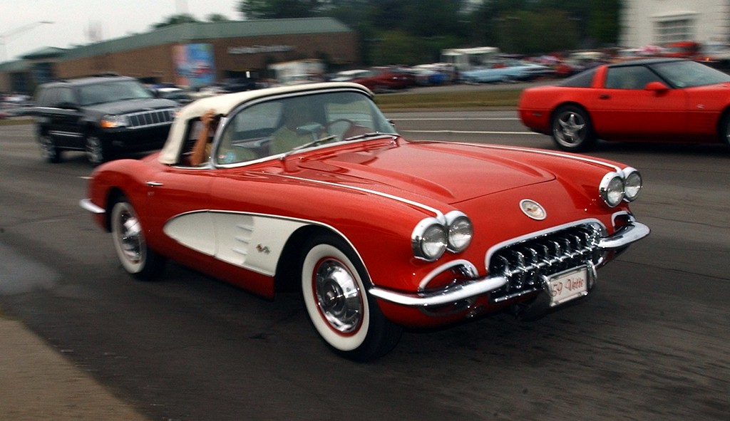 . A 1959 Corvette cruises Woodward during the 16th Annual Woodward Dream Cruise in Royal Oak. (Oakland Press Photo/Vaughn Gurganian)