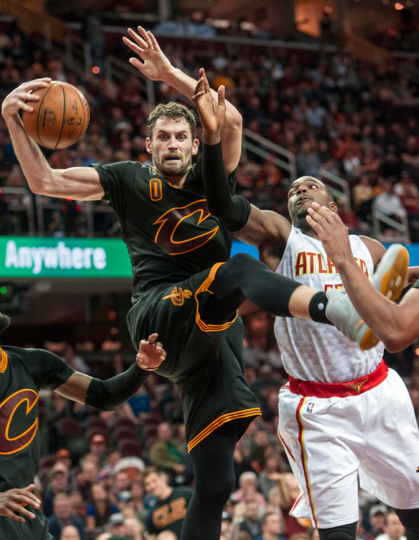 . Cleveland Cavaliers\' Kevin Love (0) grabs a rebound in front of Atlanta Hawks\' Paul Millsap (4) during the second half of an NBA basketball game in Cleveland, Tuesday, Nov. 8, 2016. (AP Photo/Phil Long)