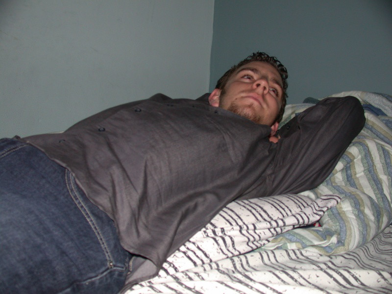 Andy revels in luxury (aka Dan's bed)