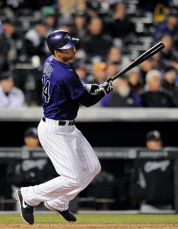 . Colorado Rockies Jordan Lyles hits a single in the fifth inning of the MLB baseball game against the Chicago White Sox on Monday, April 7, 2014, in Denver. The Rockies won 8-1. (AP Photo/Chris Schneider)