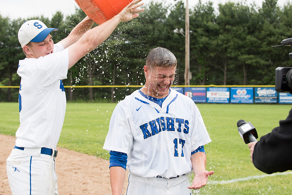 05/29/19 Wesley Bunnell | Staff Southington defeated New Britain 4-3 in 11 innings on a walk off single by Billy Carr (17) in the continuation of a game suspended in the 10th inning due to rain on May 29th. Billy Carr (17) has the water bucket ceremoniously dumped over his head during a postgame interview.