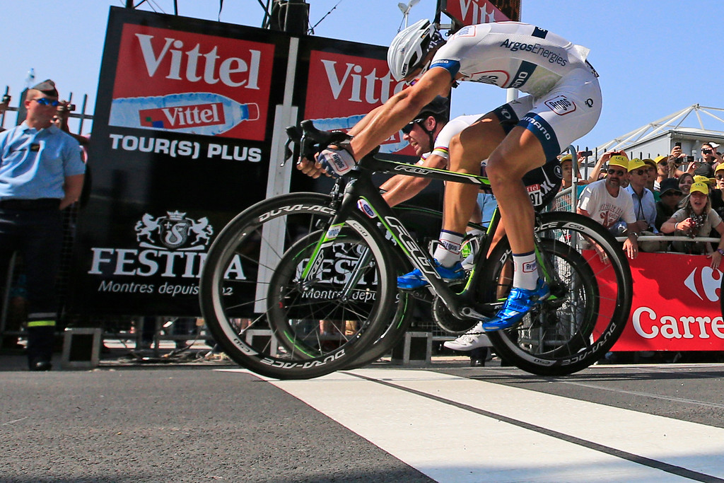 . Marcel Kittel of Germany, front, crosses the finish line ahead of Mark Cavendish of Britain, rear, to win the twelfth stage of the Tour de France cycling race over 218 kilometers (136.2 miles) with start in in Fougeres and finish in Tours, western France, Thursday July 11 2013. (AP Photo/Peter Dejong)