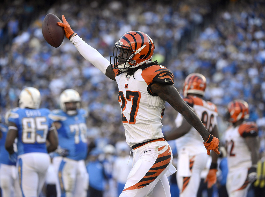 . Dre Kirkpatrick #27 of the Cincinnati Bengals recovers a fumble against the San Diego Chargers on December 1, 2013 at Qualcomm Stadium in San Diego, California. (Photo by Donald Miralle/Getty Images)