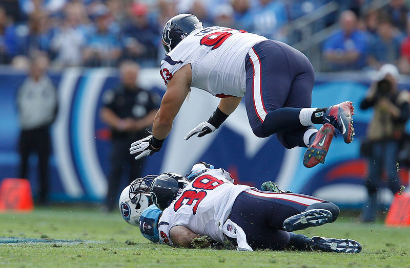 . Houston Texans\' defensive end Jared Crick (93) leaps over safety Danieal Manning (38) as they tackle Tennessee Titans\' tight end Jared Cook (89) in the first half of their NFL football game in Nashville, Tennessee December 2, 2012. REUTERS/Harrison McClary