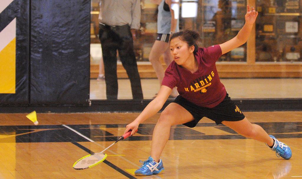 . Harding\'s Panyai Vue returns a volley to her opponent. (Pioneer Press: John Autey)