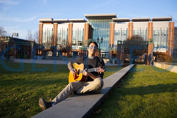 Evan Panzer Playing Guitar on the Green