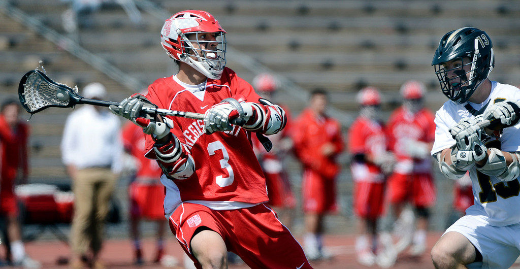 . LITTLETON, CO. - MAY 04:  Regis Jesuit\'s Aaron Horvat is defended by Arapahoe\'s Kiely O\'Connor during the varsity high school lacrosse game between the Arapahoe Warriors and the Regis Jesuit Raiders in Littleton, CO May 04, 2013. The Raiders won the game 9-6.  (Photo By Craig F. Walker/The Denver Post)