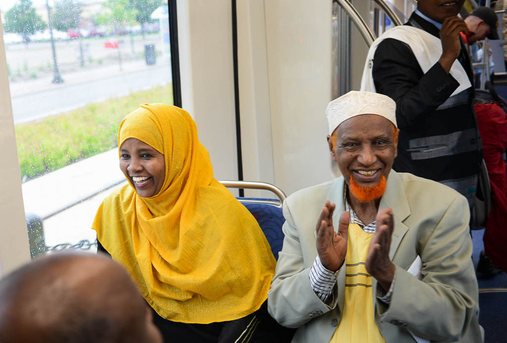 . People react after the first rain departs on opening day of the Metro Transit Green Line light rail train in St. Paul.  (Pioneer Press: Ben Garvin)