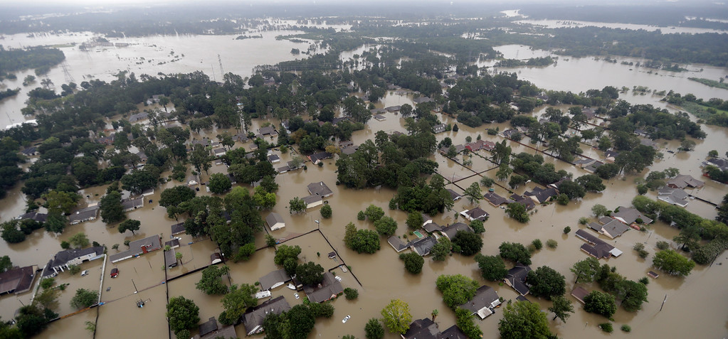 . Homes are surrounded by floodwaters from Tropical Storm Harvey Tuesday, Aug. 29, 2017, in Humble, Texas. (AP Photo/David J. Phillip)