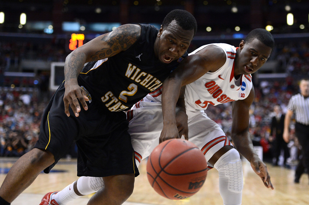 . LOS ANGELES, CA - MARCH 30:  Malcolm Armstead #2 of the Wichita State Shockers and Shannon Scott #3 of the Ohio State Buckeyes go after a loose ball in the first half during the West Regional Final of the 2013 NCAA Men\'s Basketball Tournament at Staples Center on March 30, 2013 in Los Angeles, California.  (Photo by Harry How/Getty Images)