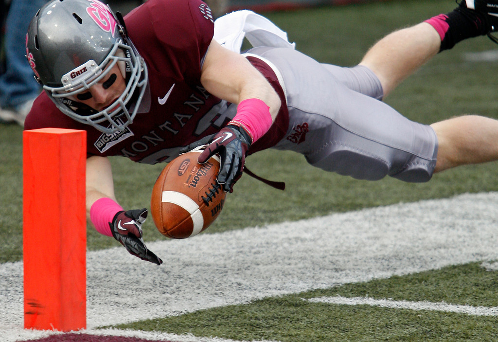 . Montana wide receiver Cam Warren comes within inches of scoring a touchdown late in the fourth quarter against Cal Poly in an NCAA college football game in Missoula, Mont., Saturday, Oct. 19, 2013. (AP Photo/Michael Albans)