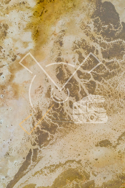 aerial image showing abstract patterns in the mud at low tide over the Awarua-Waituna Wetlands
