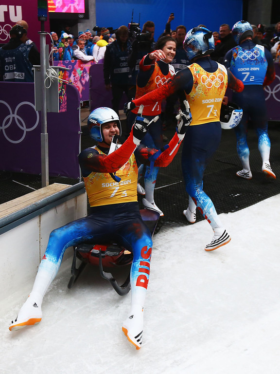 . (L-R) Alexander Denisyev, Tatyana Ivanova, Vladislav Antonov and Albert Demchenko of Russia celebrate taking the lead during the Luge Relay on Day 6 of the Sochi 2014 Winter Olympics at Sliding Center Sanki on February 13, 2014 in Sochi, Russia.  (Photo by Doug Pensinger/Getty Images)
