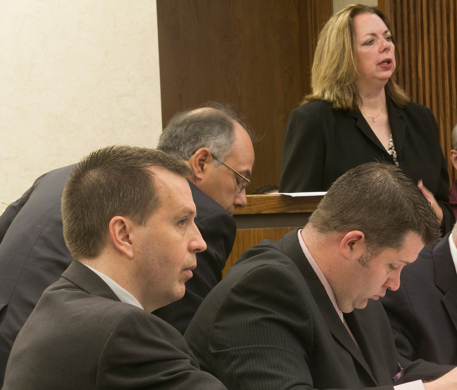 . Michael Allen Blair/MBlair@News-Herald.com Kevin Knoefel, left, and his defense team listen to witness examination by prosecutor Karen Kowall, top, during day two of testimony for Knoefel\'s conspiracy trial in Lake County Common Pleas Court on  June 3, 2014.