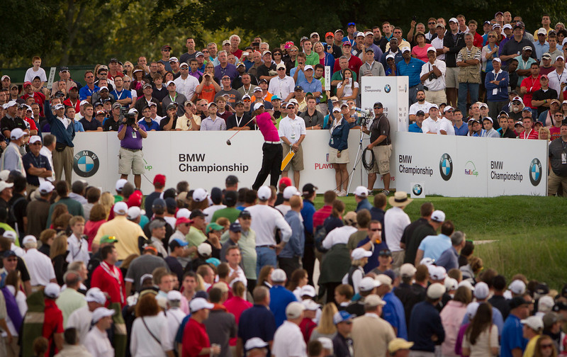 Crowds  surround Tiger Woods as he hits is tee ball on 18 at the BMW Championship in Carmel Indiana on Saturday Sept. 8, 2012. (Charles Cherney/WGA)