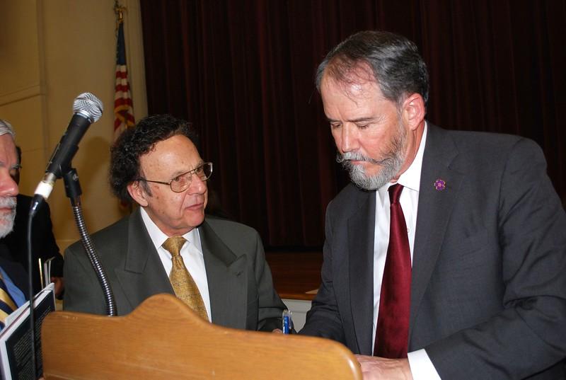 Ambassador Evans signing his book for Dn. Gregory Krikorian