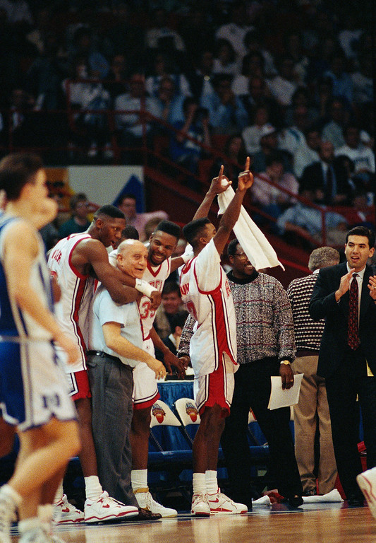 . UNLV coach Jerry Tarkanian is hugged by players as the final seconds of the Final Four tick towards victory over Duke University. The Runnin\' Rebels beat the Blue Devils 103-73 for the biggest margin of victory in a Final Four Championship Game on April 2, 1990 in Denver. (AP Photo/Eric Risberg)