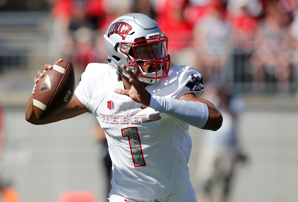 . UNLV quarterback Armani Rogers throws a pass against Ohio State during the first half of an NCAA college football game Saturday, Sept. 23, 2017, in Columbus, Ohio. (AP Photo/Jay LaPrete)