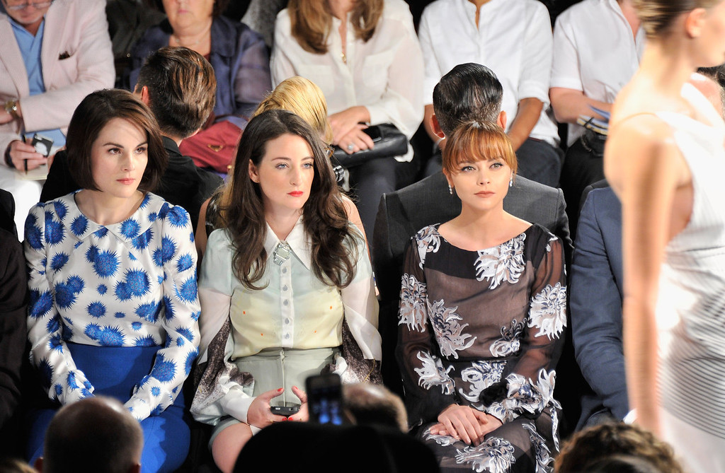 . Actresses Michelle Dockery (L) and Christina Ricci (R) attend the Carolina Herrera fashion show during Mercedes-Benz Fashion Week Spring 2014 at The Theatre at Lincoln Center on September 9, 2013 in New York City.  (Photo by Stephen Lovekin/Getty Images for Mercedes-Benz Fashion Week Spring 2014)