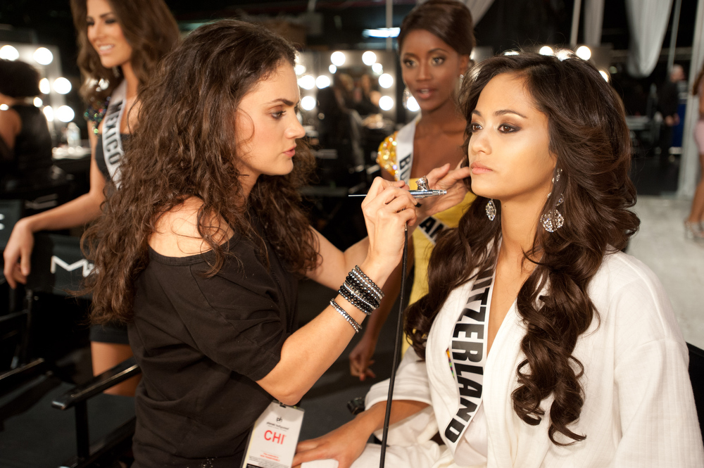 Description of . Miss Switzerland 2012, Alina Buchschacher, gets her makeup done by MAC artist, Danielle Doyle, backstage during the 2012 Miss Universe Presentation Show on Thursday, Dec. 13, 2012 at PH Live in Las Vegas. The 89 Miss Universe Contestants will compete for the Diamond Nexus Crown on December 19.  (AP Photo/Miss Universe Organization L.P., LLLP)
