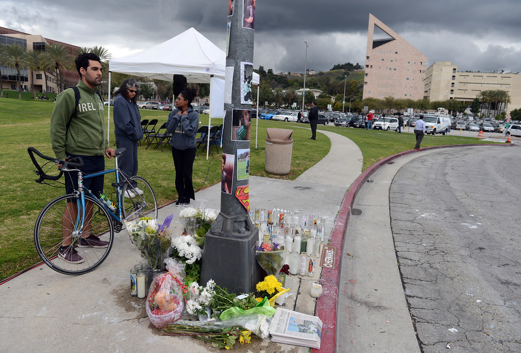 """. Friends and family gather to remember Cal Poly student Ivan Arturo Aguilar Thursday, March 7, 2013, at Cal Poly Pomona in Pomona. A \""""ghost bike\"""" was installed and a memorial bike ride was held in his memory. Aguilar was killed after he was hit by a car while riding his bike on campus last week. Jennifer Cappuccio Maher/Staff Photographer"""
