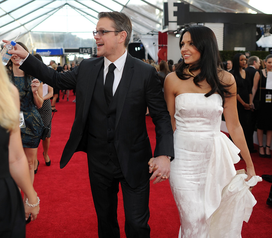 . Actor Matt Damon (L) and Luciana Barroso on the red carpet at the 20th Annual Screen Actors Guild Awards  at the Shrine Auditorium in Los Angeles, California on Saturday January 18, 2014 (Photo by Hans Gutknecht / Los Angeles Daily News)