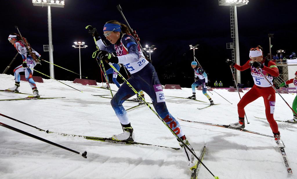 . United States\' Susan Dunklee, center, leads Switzerland\'s Selina Gasparin as she competes in the women\'s biathlon 12.5k mass-start, at the 2014 Winter Olympics, Monday, Feb. 17, 2014, in Krasnaya Polyana, Russia. (AP Photo/Felipe Dana)