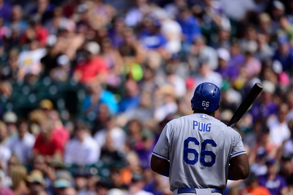 . Yasiel Puig (66) of the Los Angeles Dodgers waits to bat against Chad Bettis (35) of the Colorado Rockies during the action in Denver on Monday, September 2, 2013. The Colorado Rockies hosted the Los Angeles Dodgers at Coors Field.   (Photo by AAron Ontiveroz/The Denver Post)