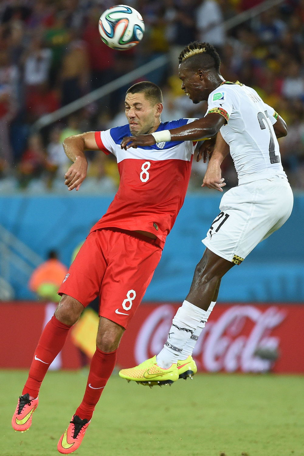 Description of . US forward Clint Dempsey (L) jumps for the ball with Ghana's defender John Boye (R) during a Group G football match between Ghana and US at the Dunas Arena in Natal during the 2014 FIFA World Cup on June 16, 2014.  AFP PHOTO / EMMANUEL DUNANDEMMANUEL DUNAND/AFP/Getty Images