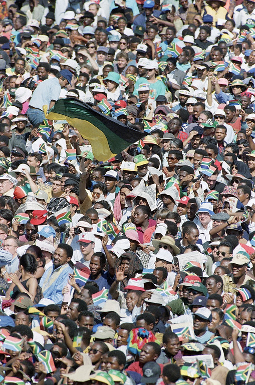 . Large crowds of supporters attend the inauguration celebration in a park adjoining the Union Buildings in Central Pretoria, South Africa, Tuesday, May 10, 1994 on the occasion of President Nelson Mandela\'s being sworn in an South Africa\'s black President. (AP Photo/John Parkin)
