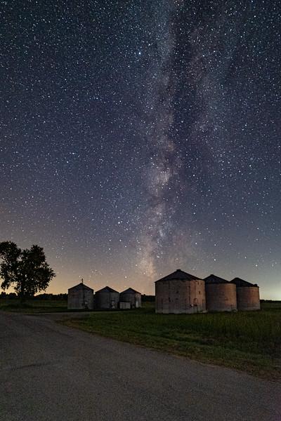 Grain silos under the stars