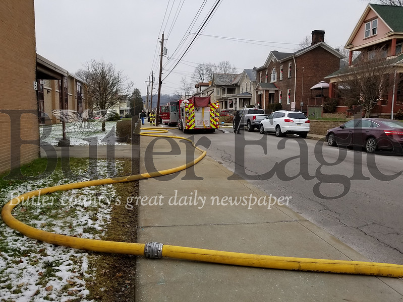 Fire crews responded to multiple calls about a house fire on West Penn Street, across from Emily Brittain Elementary School. Photo by Nathan Bottiger.