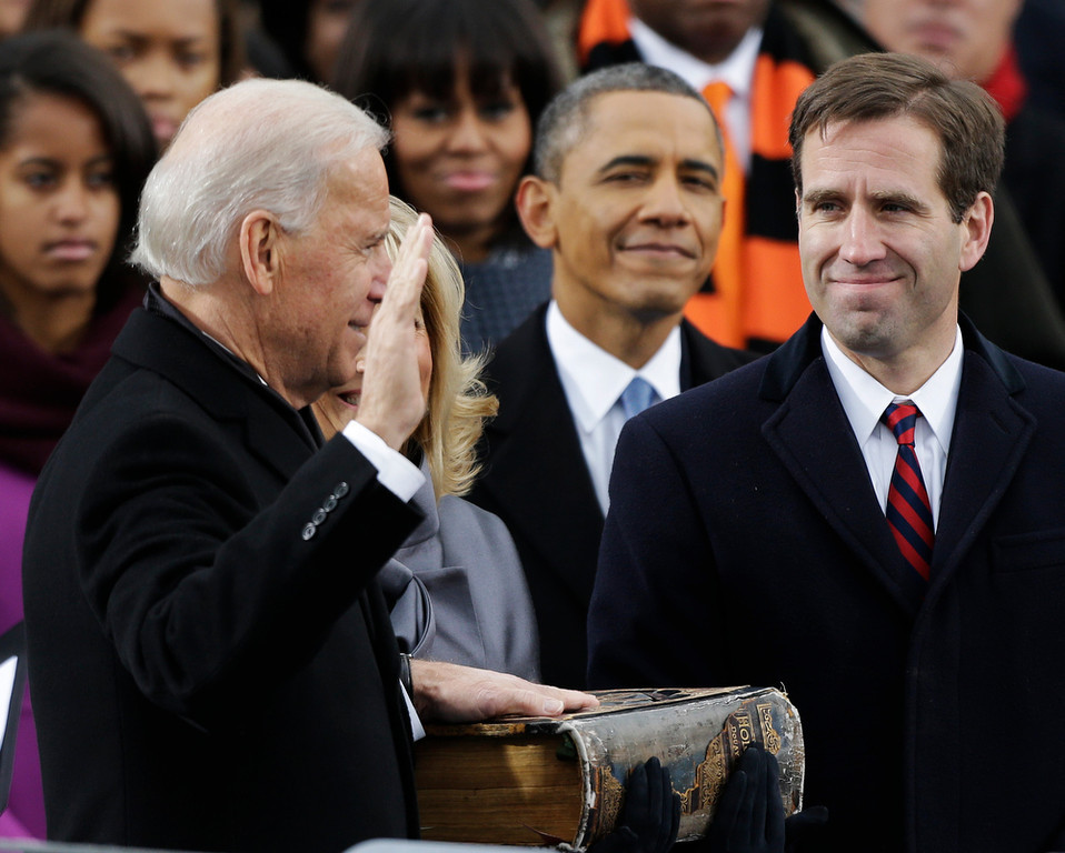 . President Barack Obama, center and Beau Biden, Attorney of Deleware, right, watch as his father Joe Biden is sworn in at the ceremonial swearing-in at the U.S. Capitol during the 57th Presidential Inauguration in Washington, Monday, Jan. 21, 2013. (AP Photo/Pablo Martinez Monsivais)