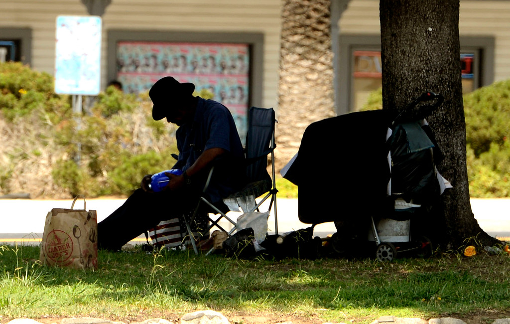 . A homeless man sits in the center divider of East Colton Avenue in Redlands August 16, 2013.  Homelessness has become a large problem in the San Bernardino County area. GABREL LUIS ACOSTA/STAFF PHOTOGRAPHER.