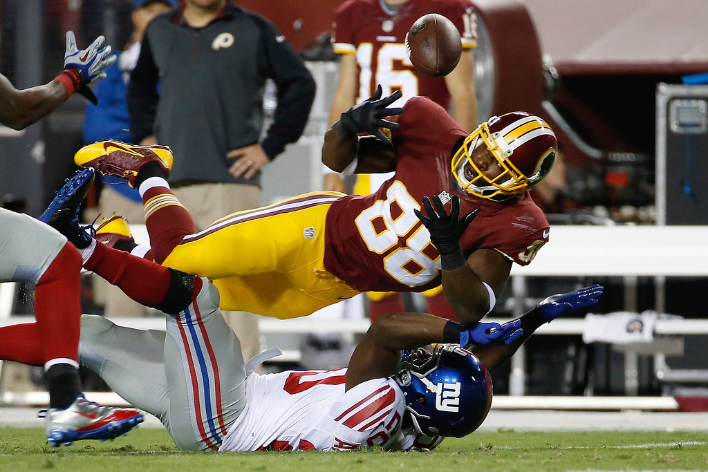 . Washington Redskins wide receiver Pierre Garcon (88) tries to recover an incomplete  pass broken up by New York Giants cornerback Prince Amukamara, bottom, during the second half of an NFL football game in Landover, Md., Thursday, Sept. 25, 2014. (AP Photo/Alex Brandon)