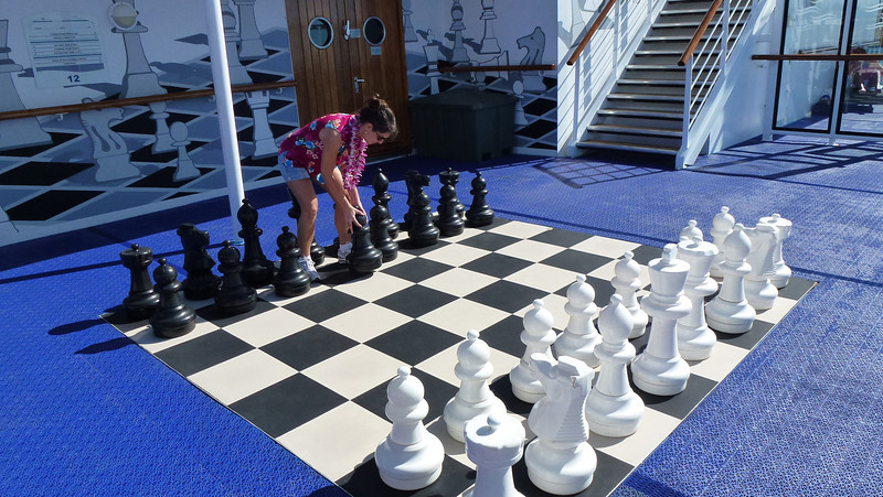 Diane trying her hand at chess (don't pay too close attention...she's moving the pawn in the wrong direction). =)