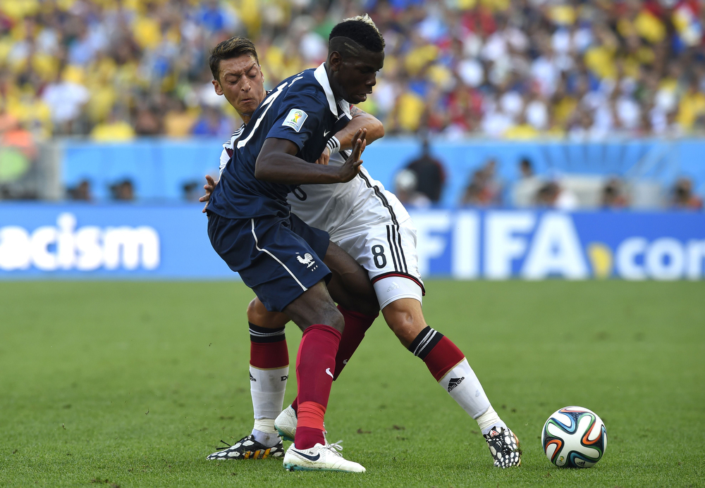 . France\'s midfielder Paul Pogba (front) and Germany\'s midfielder Mesut Ozil vie for the ball during the quarter-final football match between France and Germany at the Maracana Stadium in Rio de Janeiro during the 2014 FIFA World Cup on July 4, 2014. (FRANCK FIFE/AFP/Getty Images)