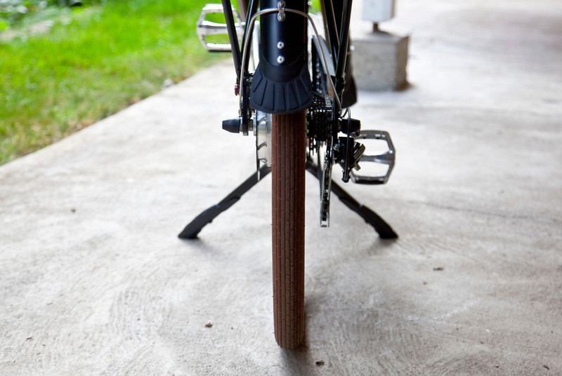 Straight on rear view of the Ursus Jumbo Double Kickstand mounted and deployed on the Pedego City Commuter.