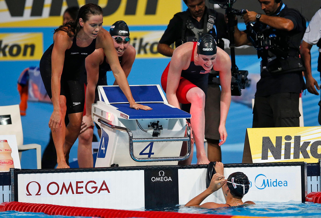 . United States\' Natalie Coughlin, left, Shannon Vreeland and Missy Franklin, right, celebrate after Megan Romano anchored them to the gold medal in the Women\'s 4x100m freestyle relay final at the FINA Swimming World Championships in Barcelona, Spain, Sunday, July 28, 2013. (AP Photo/Michael Sohn)