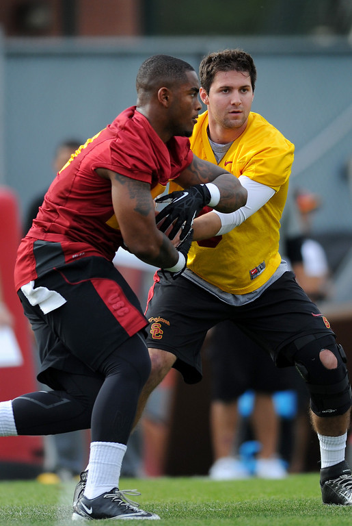 . USC QB Cody Kessler hands off to RB Tre Madden at spring practice, Tuesday, March 11, 2014, at USC. (Photo by Michael Owen Baker/L.A. Daily News)