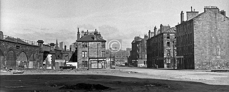 Hospital St, a looser crop of a shot I've already posted. The modern road from Cathcart Rd to the Saltmarket passes within a few yards of the railway arches on the left.   April 1973