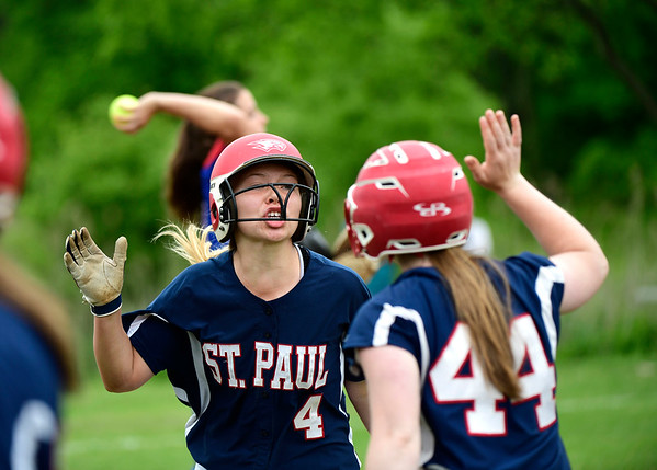 5/30/2019 Mike Orazzi | Staff St. Paul's Ava Hampton (4) and Abby Poirot (44) during a 6-4 win over Hale Ray in a Class S Second Round softball game in Bristol Thursday.