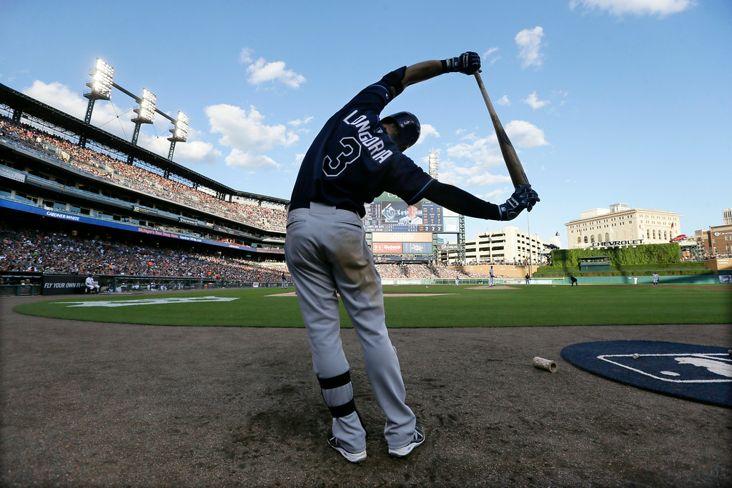 . Tampa Bay Rays\' Evan Longoria stretches as he waits for his turn to bat during the third inning of a baseball game against the Detroit Tigers in Detroit, Friday, July 4, 2014. (AP Photo/Carlos Osorio)